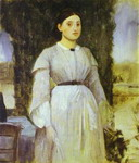 Young Woman Standing Next to a Table.